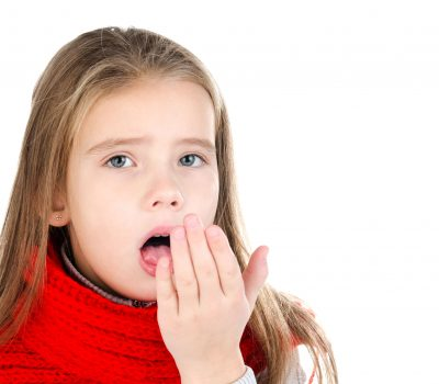 48705726 - sick little girl in red scarf coughing isolated on a white background